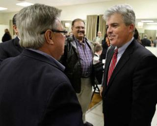 hoto by John Dunn | Newly elected Suffolk County Executive Steve Bellone, right, greets Chamber of Commerce members from across Suffolk County at a small business roundtable Monday at the VFW in Kings Park.